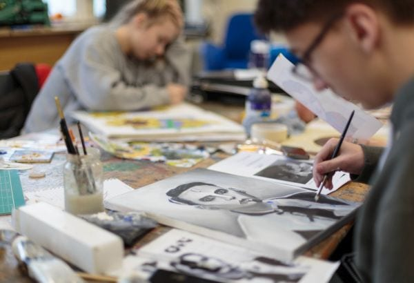 Art students sat drawing in their classroom