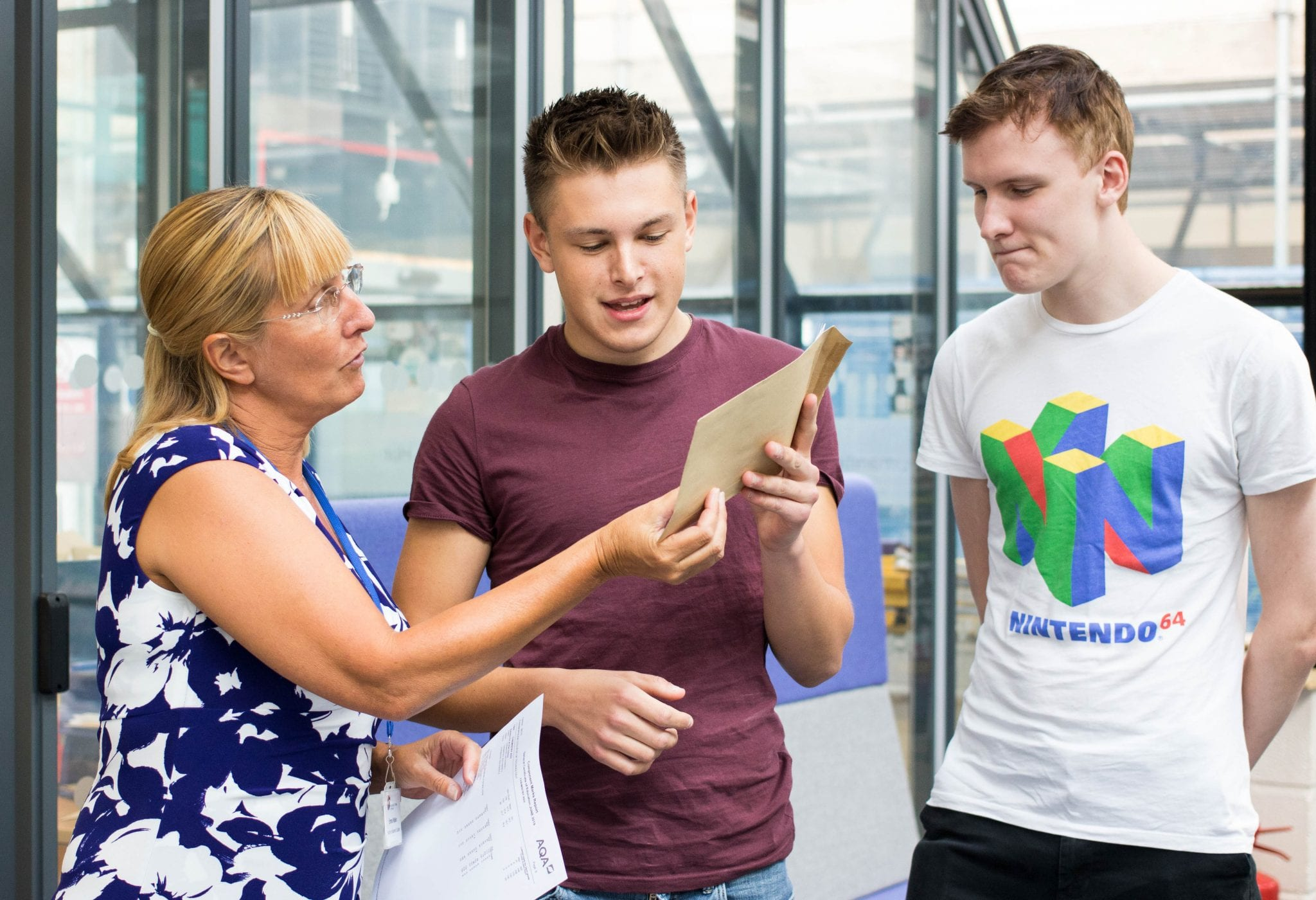 Lecturer chats with her students as they get their A level results