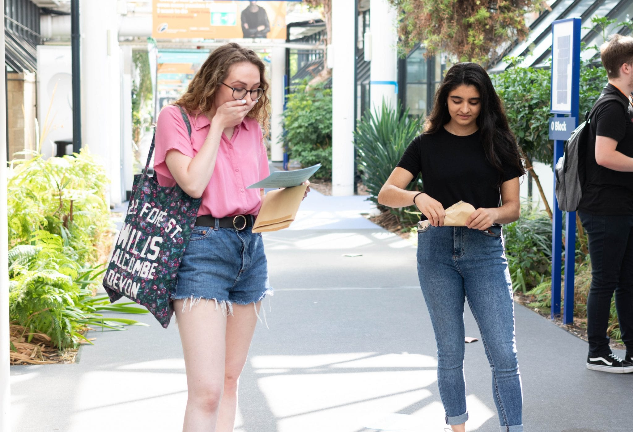 A level students receiving great exam results
